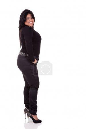 Portrait of a latin happy big girl. Isolated over white, studio shot