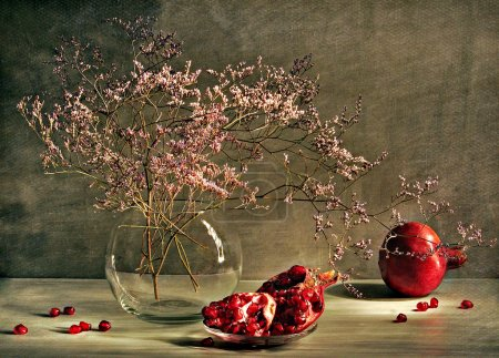 Still Life with a branch and garnet