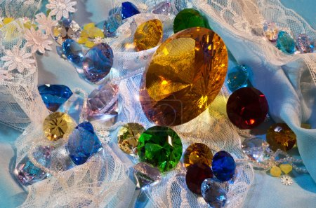 Collection of glass gems with yellow in center...