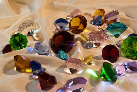 Collection of glass gems with red in center...
