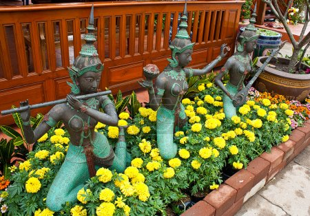Photo for Ancient statues of Thai women. In playing a musical instrument - Royalty Free Image