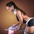 Woman dressed in a sexy French Maid costume ironing panties