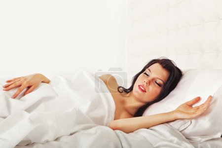 Cute brunette woman sleeping, healthy dream in white bed