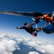 Skydivers jumping from airplane...