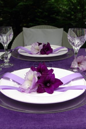 Table decoration with gladiolus. To the romantic rendezvous