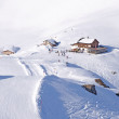 Ski piste and hut with a bar viewed from the summi...