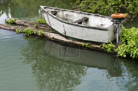 Small skiff with vintage motor