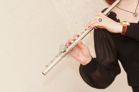 Flute in hand