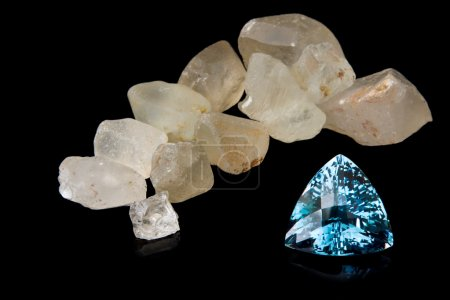 Trilliant Cut Blue Topaz And Rough Stones