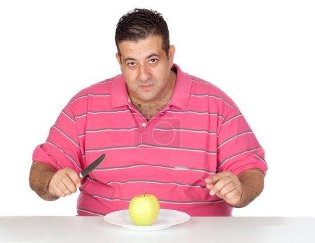 Fat man eating a apple