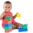 Baby girl playing with building blocks over white ...