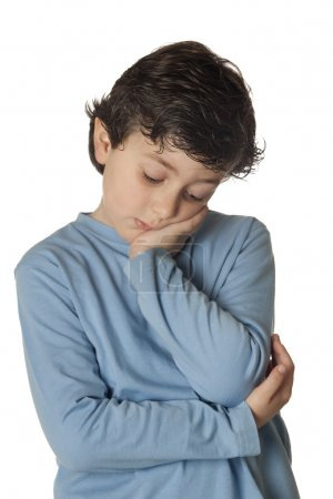 Sad child with blue shirt