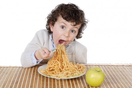Photo for Adorable child hungry at the time of eating a over white background - Royalty Free Image