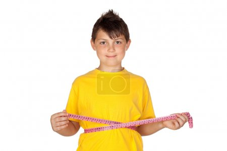 Funny child with yellow t-shirt with a tape measure