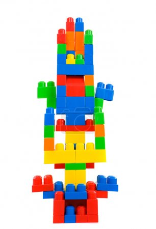 Photo for Many colored pieces forming one tower isolated on white - Royalty Free Image