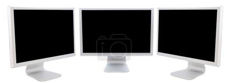 Photo pour Trois moniteurs d'ordinateurs en noir sur fond blanc - image libre de droit