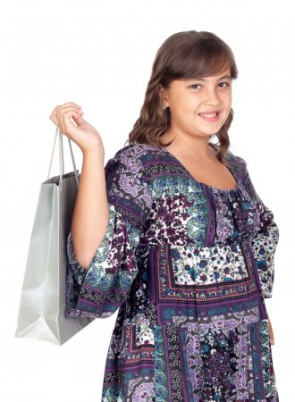 Adorable preteen girl shopping