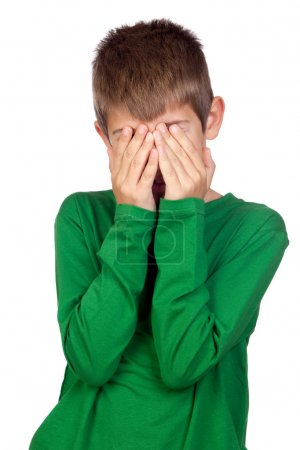 Child with green t-shirt covering his face