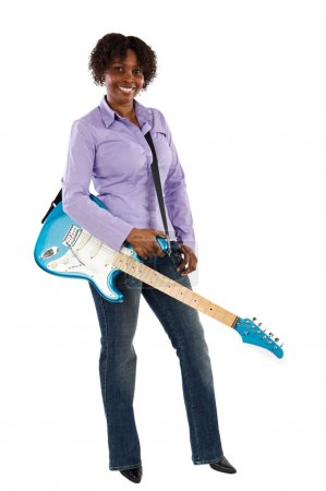 Photo for Woman with an electric guitar over a white background - Royalty Free Image