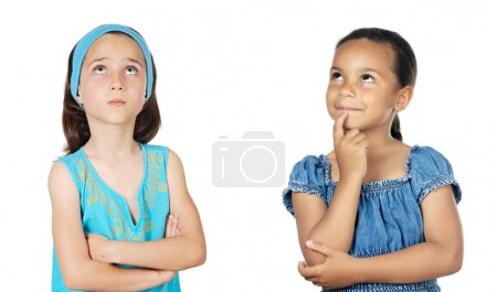 Two little girls thinking