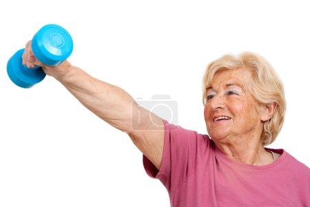 Senior woman doing fitness exercise.