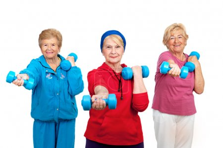 Photo for Three healthy senior women doing workout with weights.Isolated on white. - Royalty Free Image
