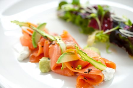 Photo for Close up of smoked salmon salad with green asparagus and avocado - Royalty Free Image