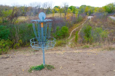 Photo for A Metal Disc Golf Catcher in Autumn - Royalty Free Image