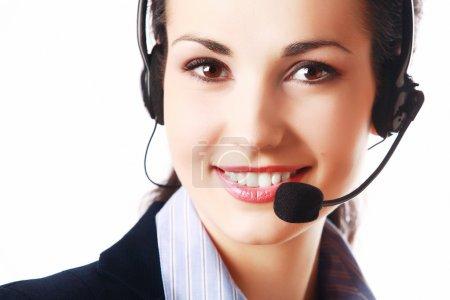 Foto de Mujer sonriente con auriculares aisladas sobre fondo blanco - Imagen libre de derechos