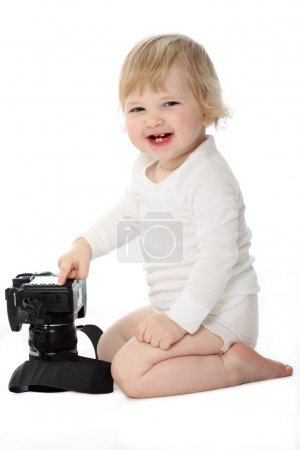 Laughing baby with camera isolated on white