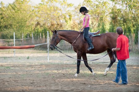 Photo for Lesson with Riding Instructor - Royalty Free Image