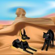 Statuette of Anubis and angry cat in sand dunes of...
