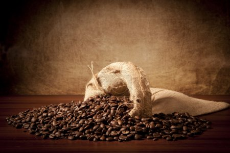 Photo for Vintage ohoto of coffe beans with old sack - Royalty Free Image