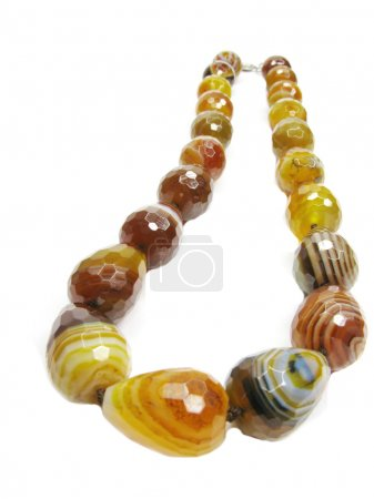 Yellow agte mineral beads jewelry isolated on whit...