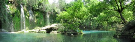 Photo for Waterfall falling view out of grotto in deep forest panorama - Royalty Free Image