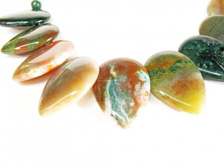 Jasper semiprecious mineral jewellery beads isolat...