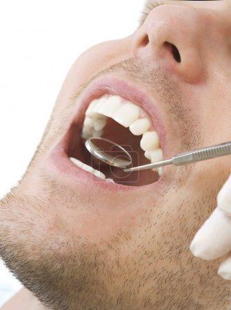 Examining patient's teeth.
