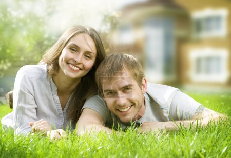 Happy Couple Near Their Home