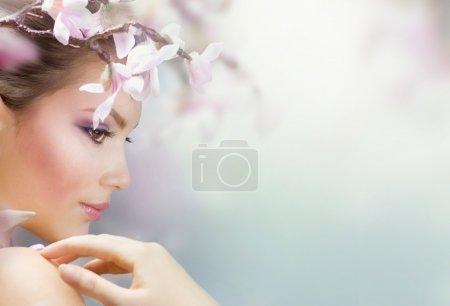 Beautiful Girl With Spring Flowers. Fresh Skin