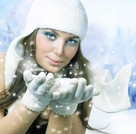 Winter Girl Blowing Snow