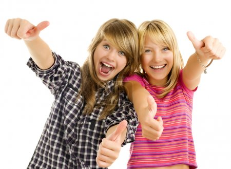 Portrait of happy teen girls showing thumbs up isolated one whit