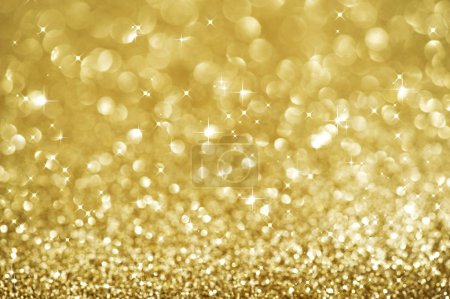 Photo for Christmas Golden Glittering background.Holiday Gold abstract texture.Bokeh - Royalty Free Image