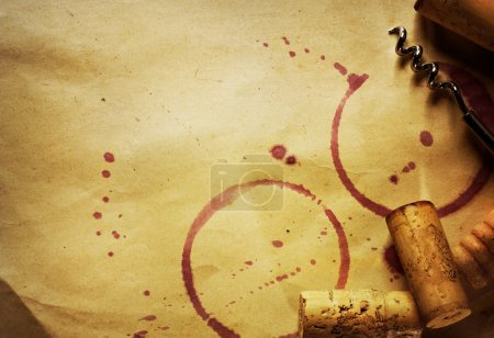 Wine Cork, Corkscrew and red wine stains on the vintage paper background