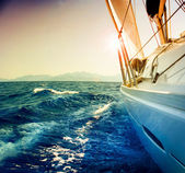 Yacht Sailing against sunset.Sailboat.Sepia toned
