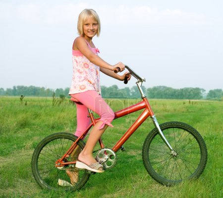 Young Little Girl On Bicycle