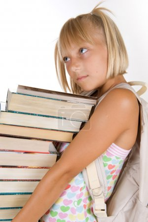 Photo for Back To School. Little Schoolgirl With Heavy Books - Royalty Free Image