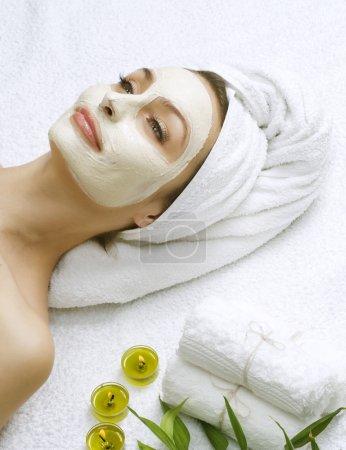 Dayspa. Clay Facial Mask. Beautiful Woman Getting Spa