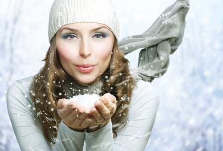Photo for Christmas Girl. Winter woman Blowing Snow - Royalty Free Image