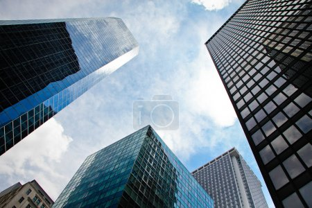 Photo for Modern building view at glass building with reflection from blue sky. - Royalty Free Image