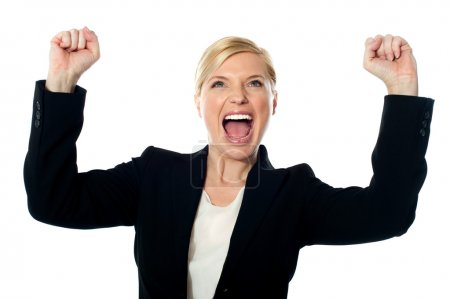Corporate lady shouting with arms up
